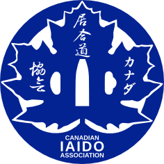 A blue circle enveloping a blue maple leaf with Japanese and English text saying Canadian Iaido Association.